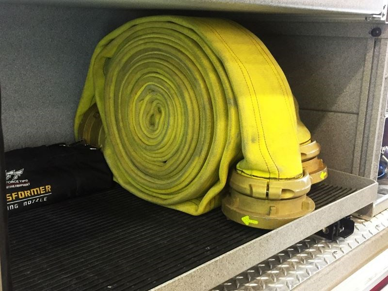 Image of Heromat, a self-draining compartment mat for fire trucks.