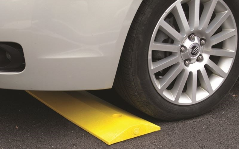 Image of a recycled plastic speed bump designed for parking lot and garage safety.